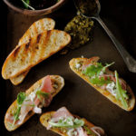 Pancetta, Blue Cheese, Pesto, and Arugula Crostini