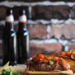 Grilled Sausage Sandwiches with Onion Sauce and Grilled Red Pepper Relish