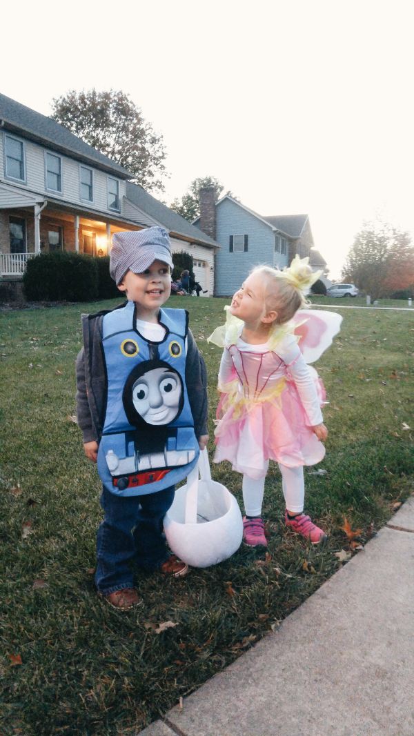 Trick-or-treating with one of his favorite gal pals
