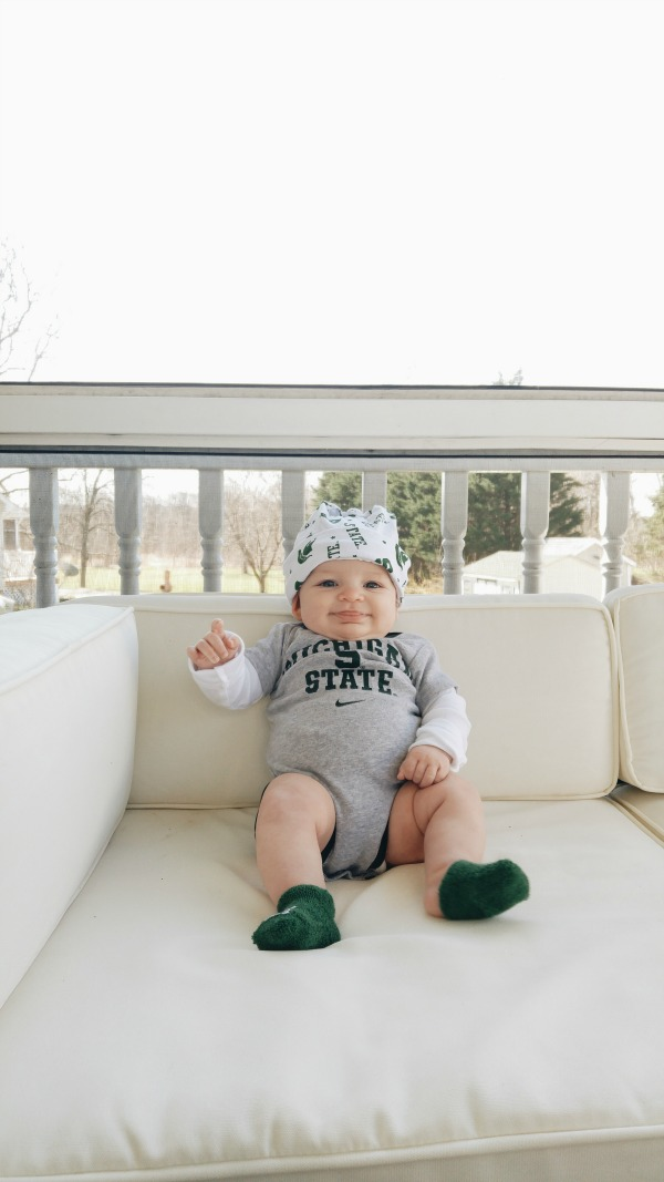 getting ready to attend her first Michigan State basketball game