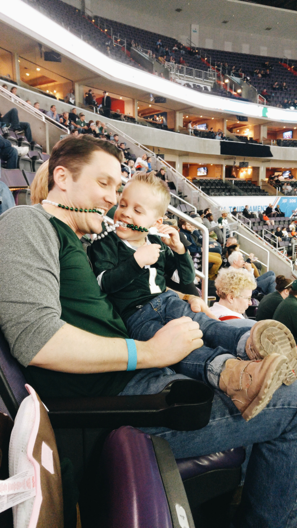 being silly at the Michigan State basketball game with Uncle KIel