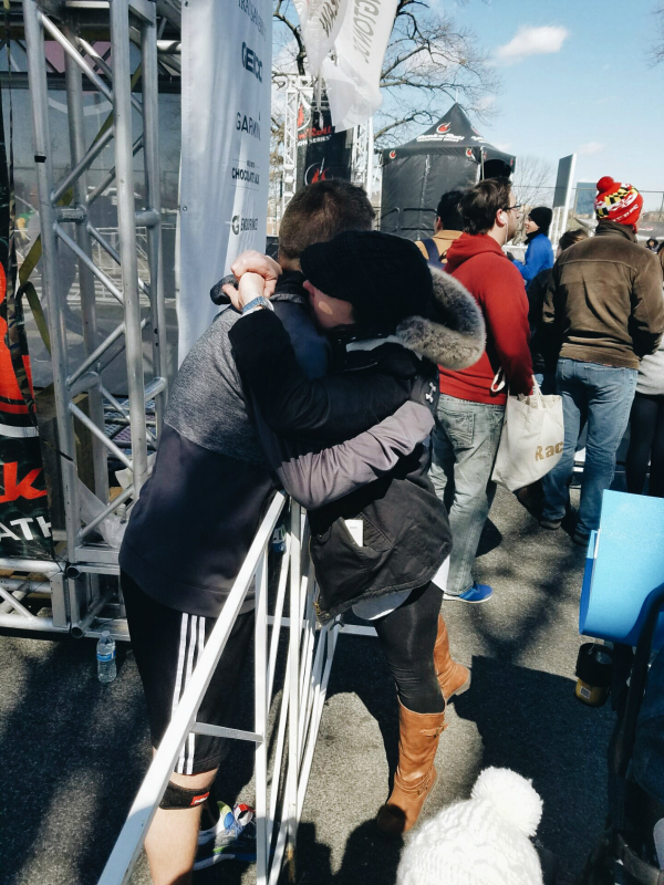 giving my husband a big hug after he ran the marathon