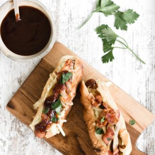 Grilled Hot Dogs with Bacon, Caramelized Onions, and Spicy Mustard Sauce
